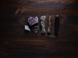 crystals and sage on a desktop