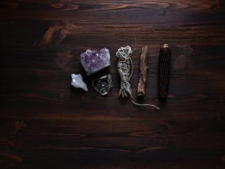 crystals and sage on a desktop
