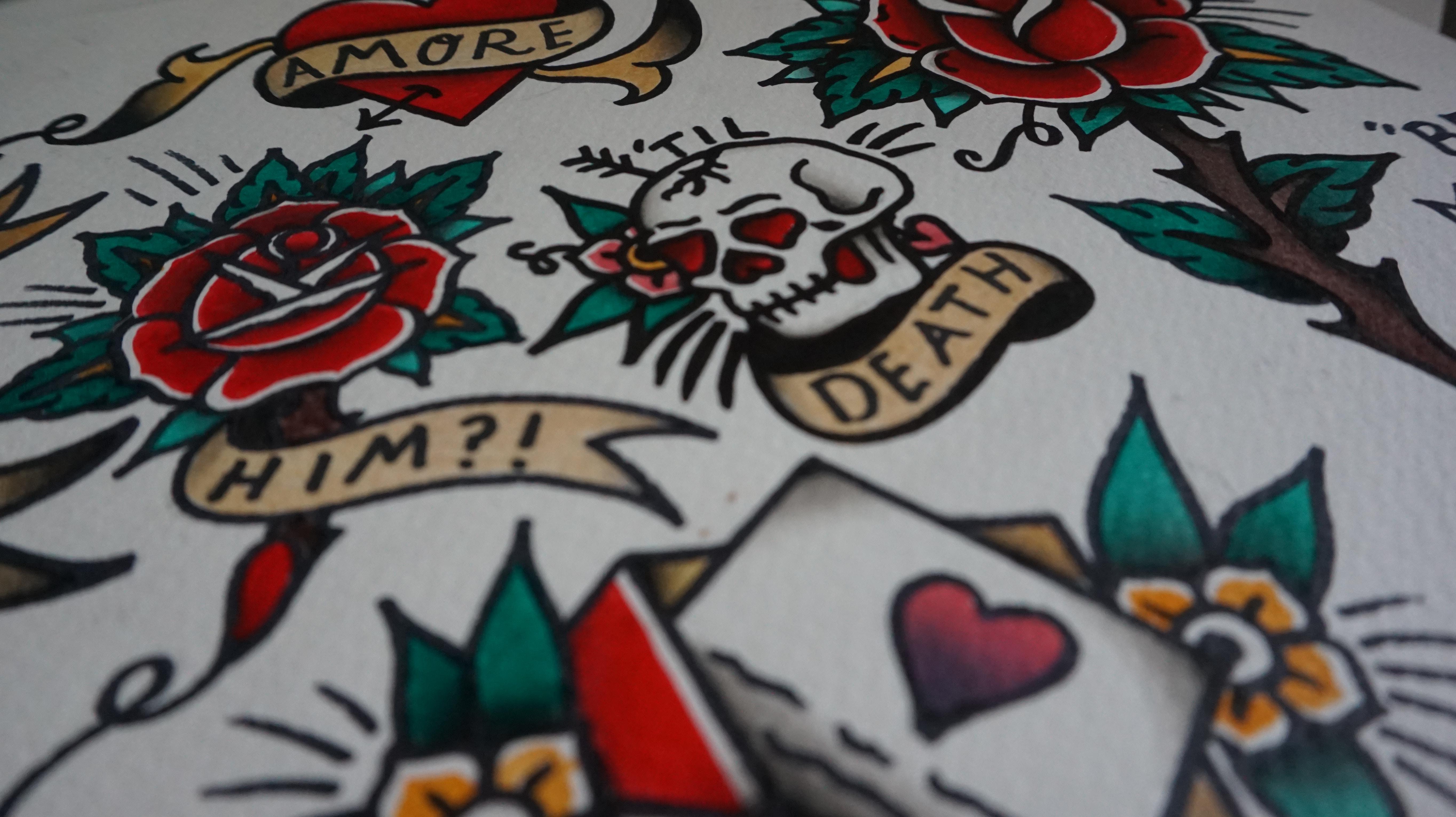 Tattoo flash sheet with skulls